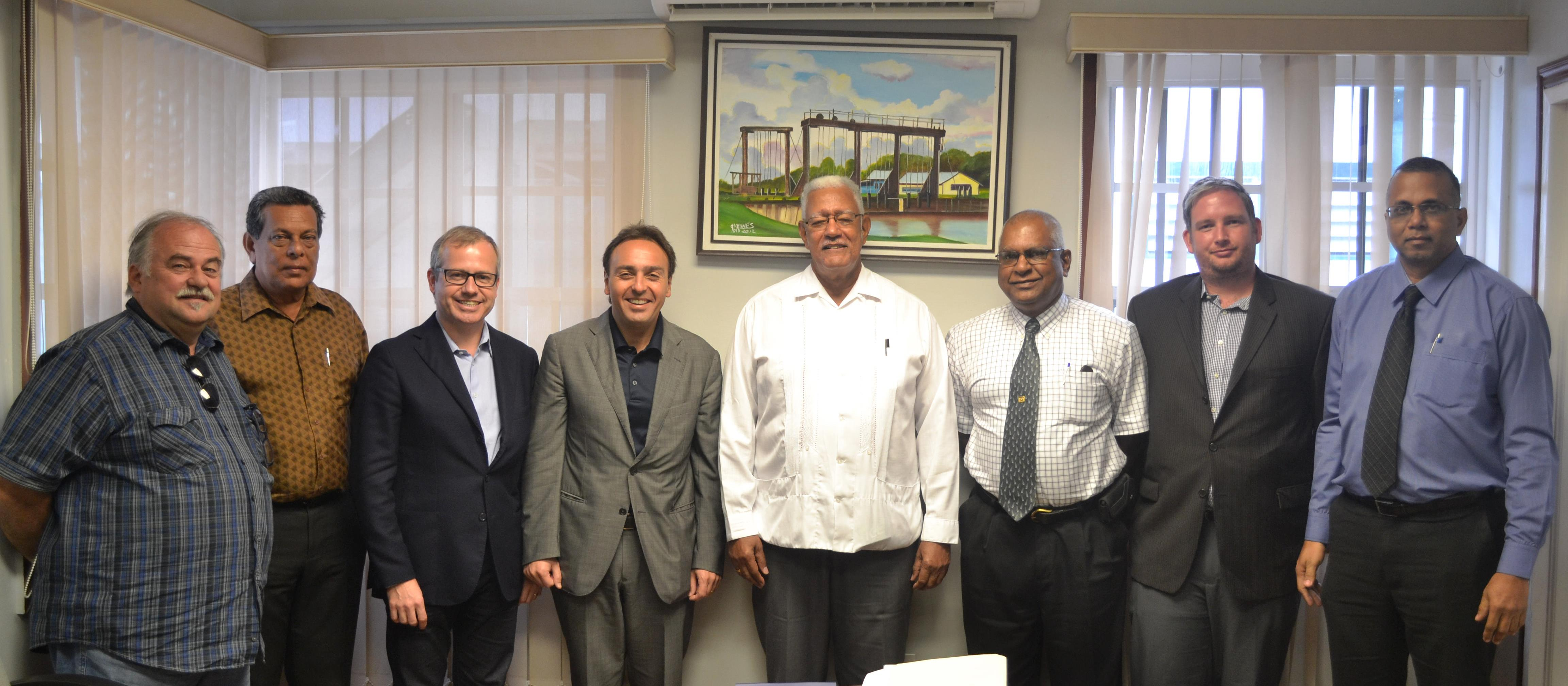 Minister Noel Holder with Mr Bruno  Sempio (left of minister) and other officials at the meeting