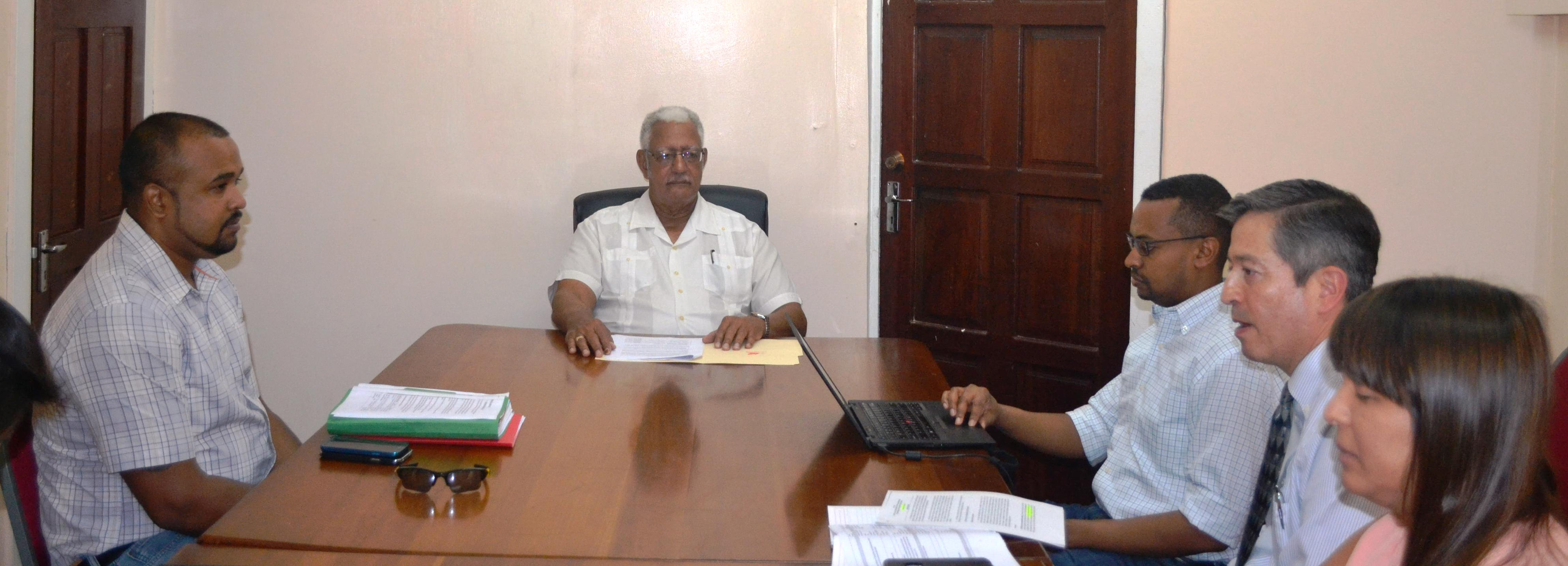 Agriculture Minister Noel Holder  during a meeting with IDB specialists. He was also accompanied by officials  from ASDU and NDIA