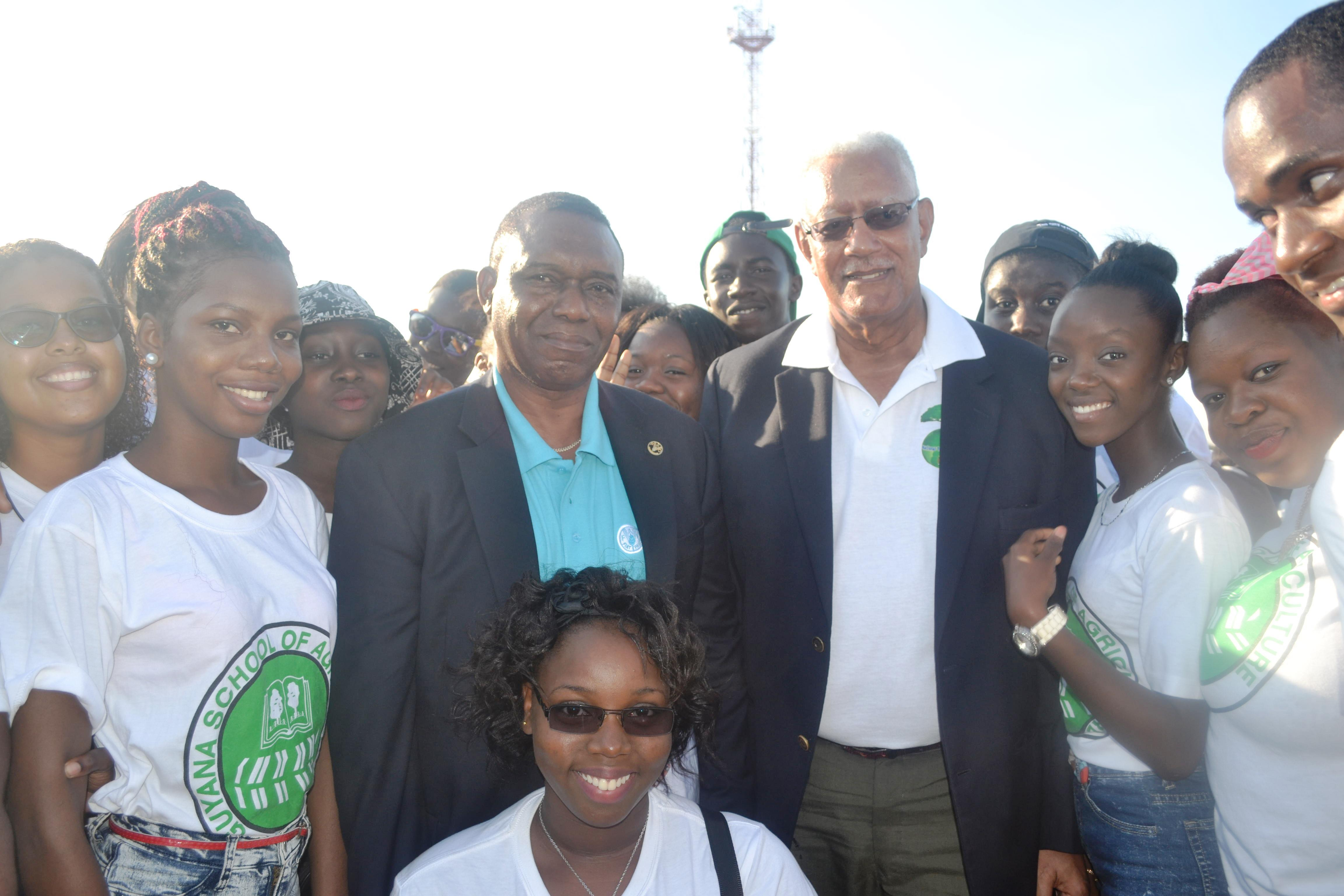 Agriculture Minister, Noel Holder  and FAO country representative with GSA students at the World Food Day  fair