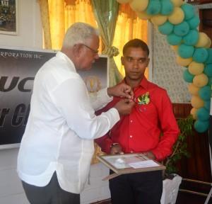Minister Holder handing over awards to awardees of GuySuCo Honour Roll for their performance in 2015.