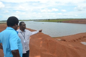 ceo-of-ndia-mr-freddy-flatts-in-discussion-with-fao-representative-at-water-harvesting-site-in-region-9
