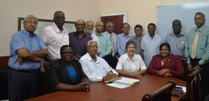 agriculture-minister-noel-holder-flanked-by-heads-of-departments-and-members-of-the-private-sector-commission-psc
