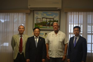 Agriculture Minister Noel Holder and China's Ambassador H.E Cui Jianchun (center) flanked by Political and Commercial Councilors respectively