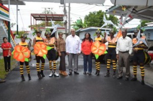 Designer of Ministry of Agriculture's Mash float and costumes, Carol Fraser with Minister of Agriculture, Noel Holder, staff and revellers displaying the costumes