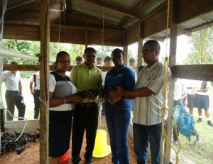 GLDA Officials handing over the Black Giant Chickens to representatives of the Mahdia Secondary School