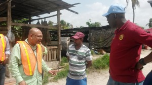 Mr. Andy Kelman and Mr. Michael Welch while speaking to one of the farmers during the field visit