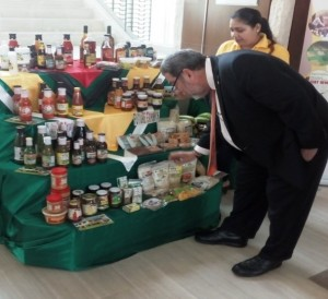 Prime Minister of St. Vincent and the Grenadines having a closer look at some of the products on display