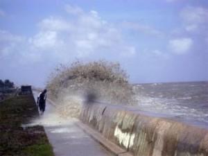 Tides overtop seawall