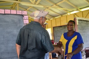 Agriculture Minister, Noel Holder while meeting Head Teacher for Baracara Primary School, Ms Kim Sampson