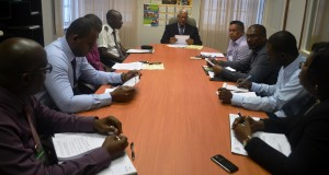 Minister Holder and other officials during the meeting
