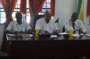 Agriculture Minister, Noel Holder (center) during the meeting. To his right is Region Ten's Regional Executive Officer (REO) Gavin Clarke and to his left another member of the council.