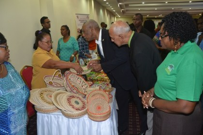 His Excellency President David Granger, Minister of Communities, Ronald Bulkan and Regional Chairperson, RDC#4, Genevieve Allen perusing some of the exhibits on display at the mini exhibition of launch.