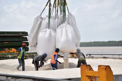 White rice being loaded onto the vessel's hatch, for shipment to Cuba