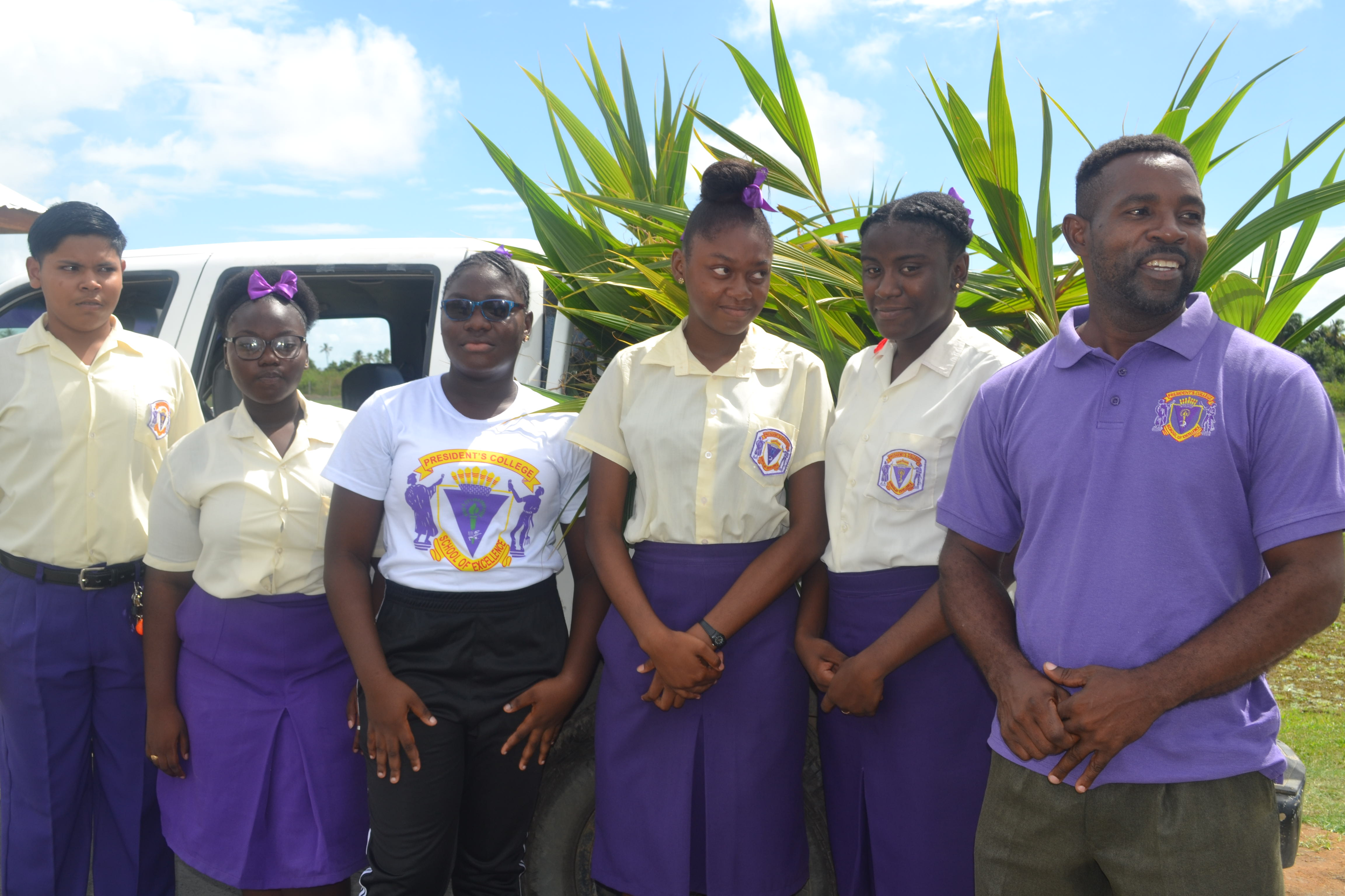 Head of the Agriculture Science Department at President's College, Mr. Cranston Richmond with some of the school's agriculture science students