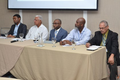 Minister Holder and other stakeholders at the head table at the CariCof stakeholders held at the Marriott today.