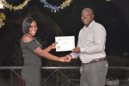 Some of the participants receiving their certificates.,