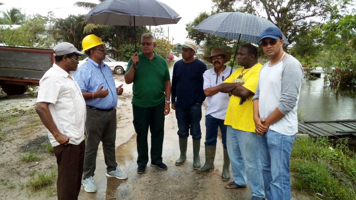 Minister Holder is pictured with NDIA CEO, Fredrick Flatts, Regional Engineer Lall Piterahdaue, NDC Chairman Dhanraj Bibath, Regional Water Users' Association Chairman Yogieraj Das and other officials