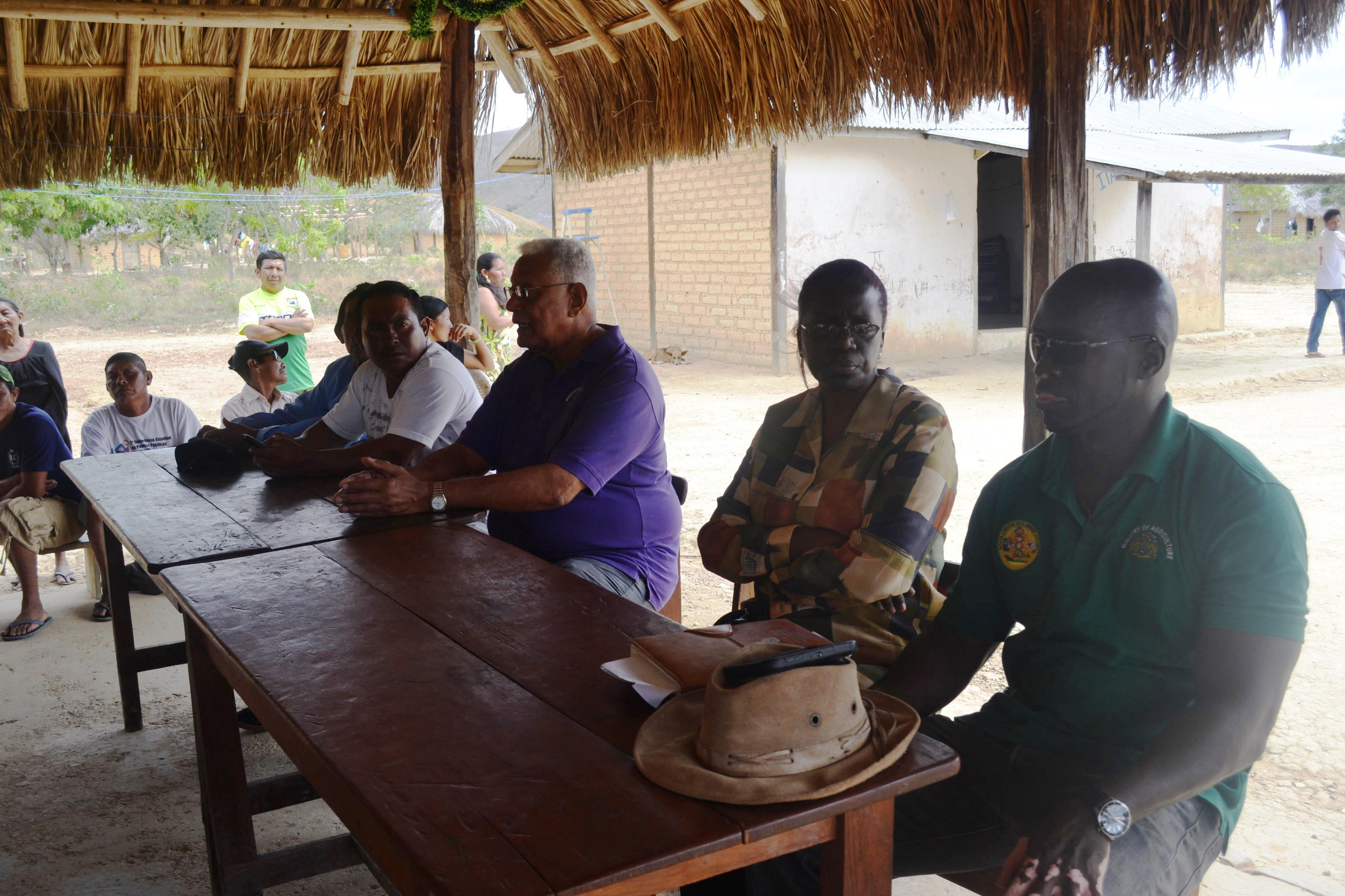 Minister Holder and other officials during a meeting with the residents of Itabac, Region 8