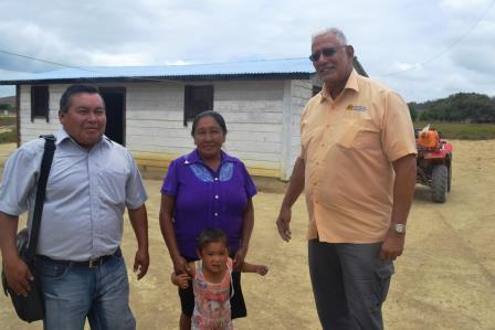 Minister Holder with Kamana Village Toshao, Jeffery Edwards and his family.