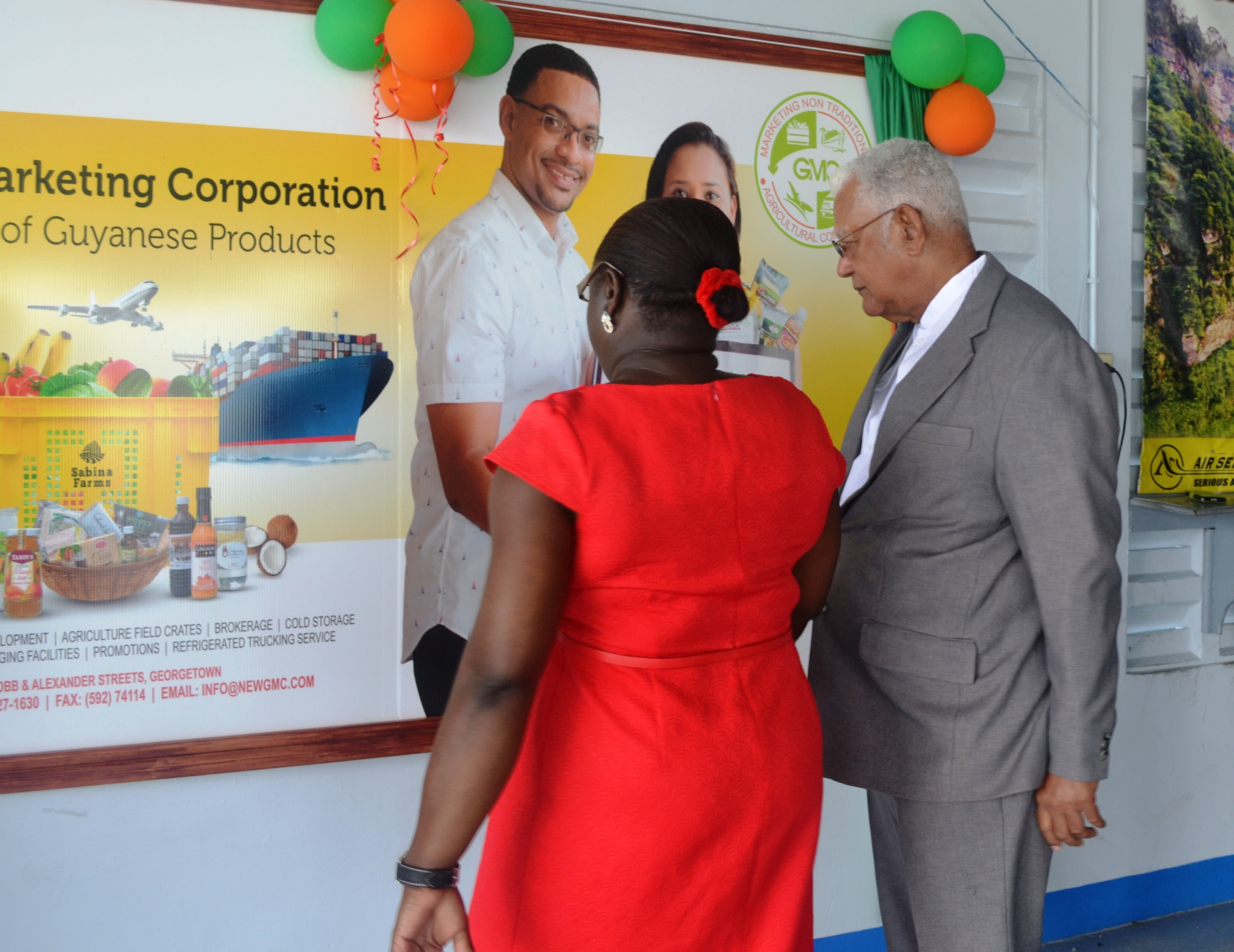 GMC General Manager, Ida Sealey-Adams while in dialogue with Agriculture Minister, Noel Holder about the agro-processors who partnered with the corporation for the project.