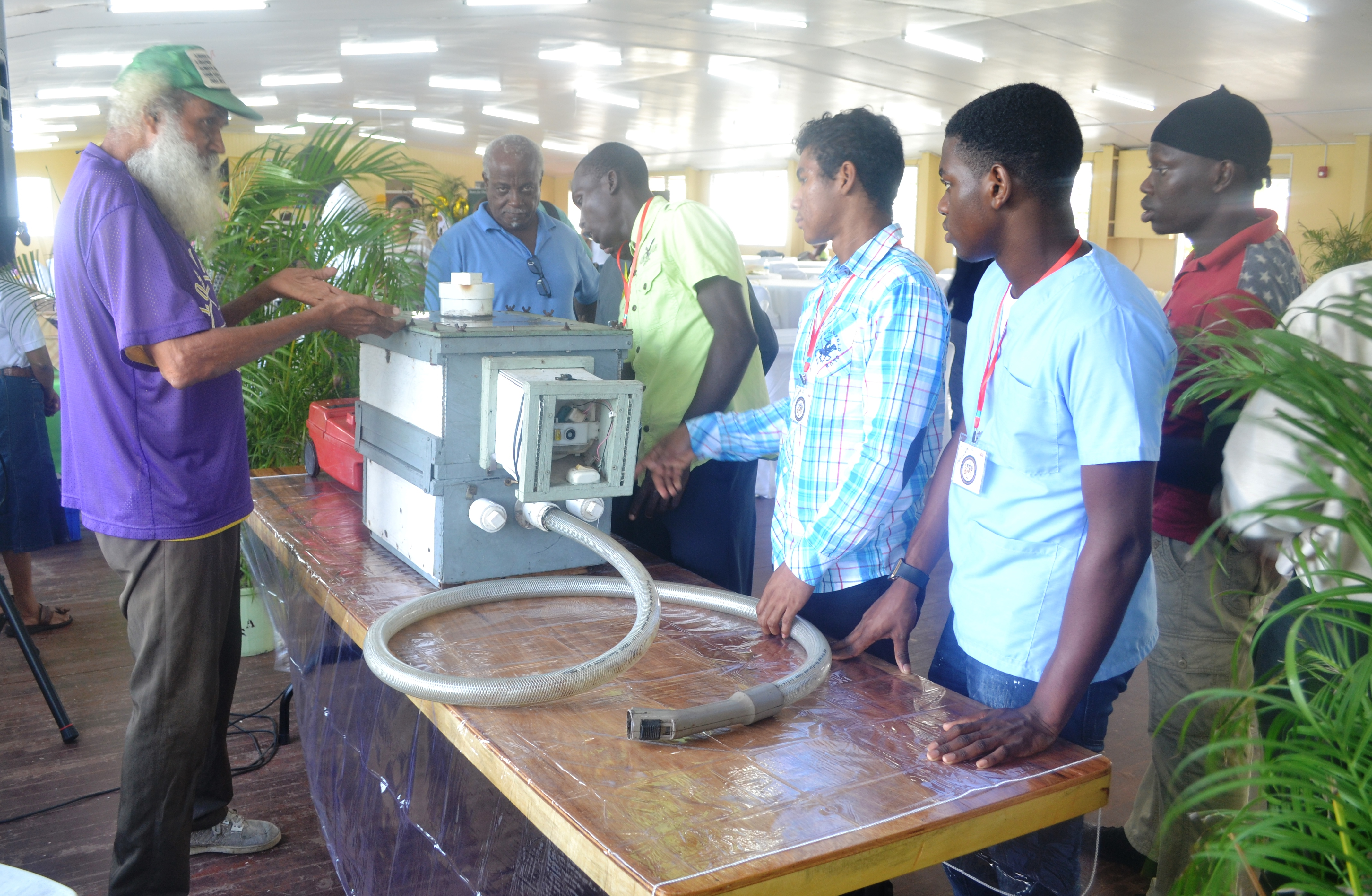 One exhibitor explaining the use of some beekeeping equipment