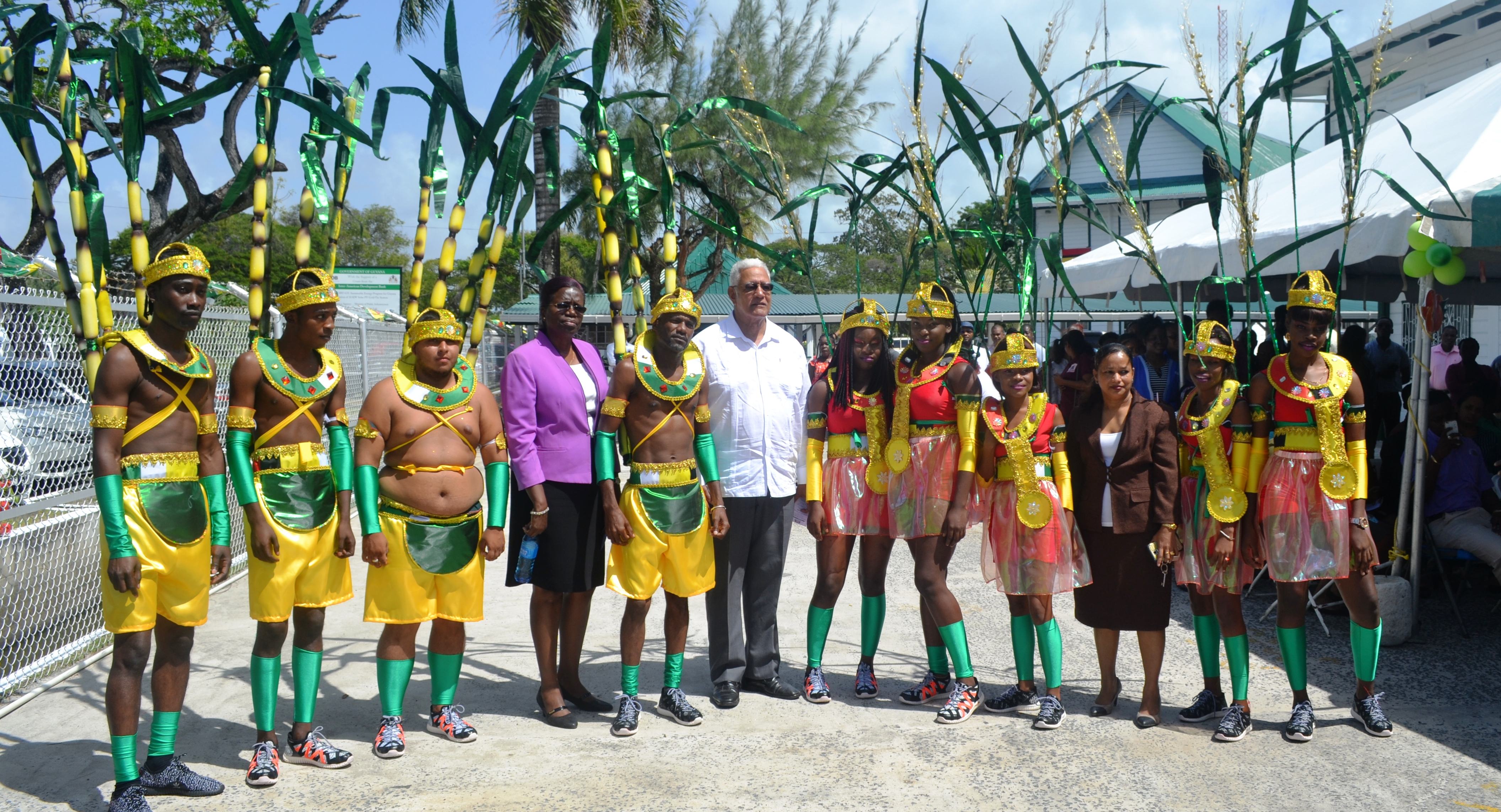Minister Holder and PS Nedd are pictured with some of the revellers who displayed the costumes