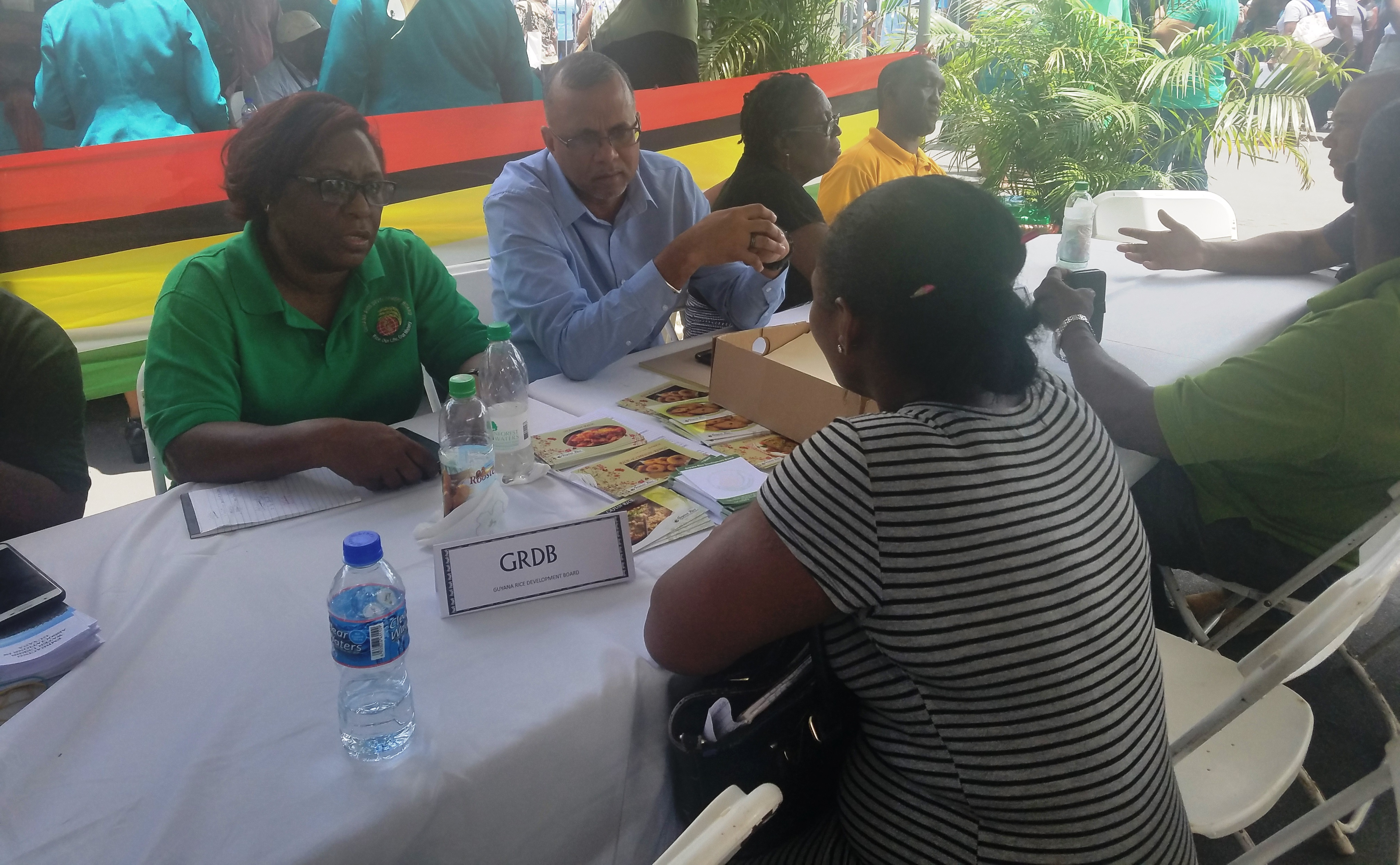 Officials from the Guyana Rice Development Board while engaging persons who visited the booth
