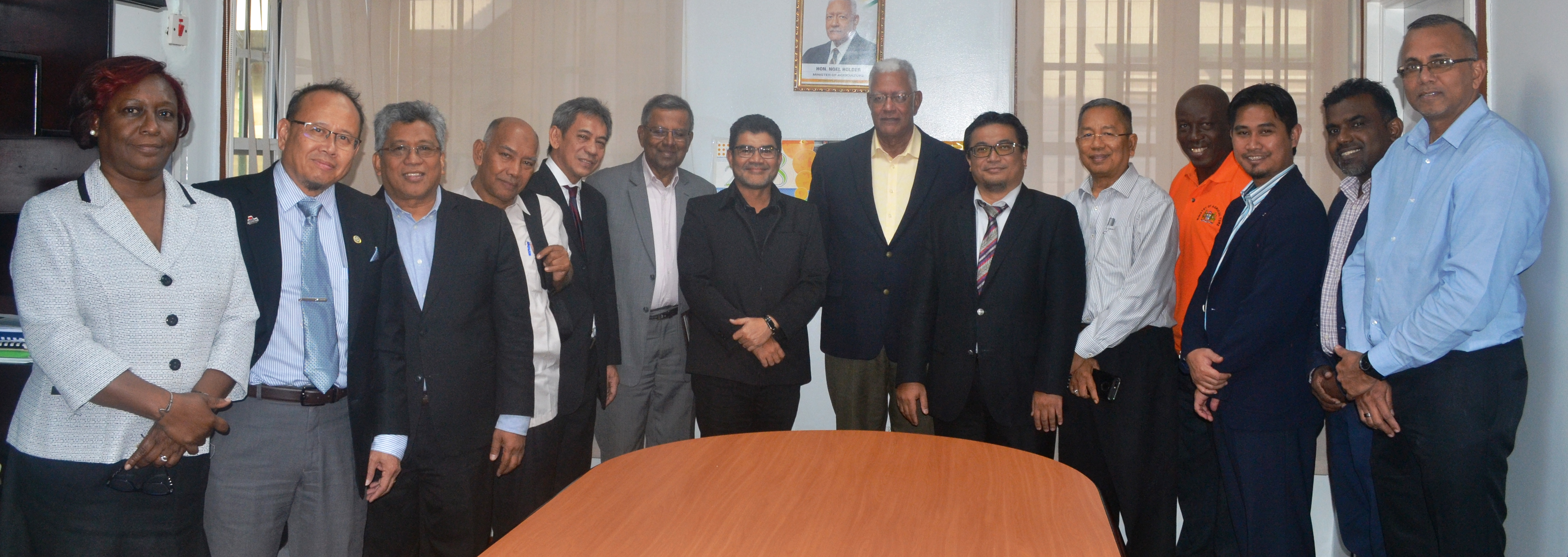 Minister Holder is pictured with the visiting team from from Malaysia and other officials from the MoA and the GRDB