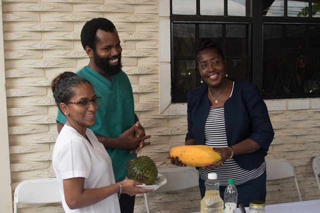 Dr. Allen, and his wife Rehana Fareed presenting Minister within the Ministry of Agriculture, Valerie Adam-Yearwood with fruit from their kitchen garden
