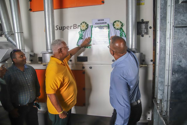 Minister of Agriculture Noel Holder and GRDB General Manager Nizam Hassan unveil the plaque commissioning the new Equipment
